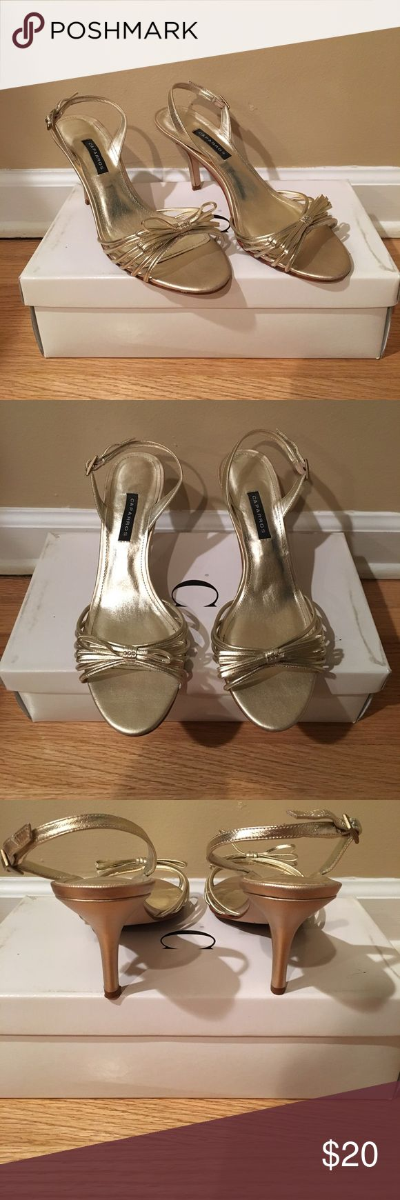 """Gold Heels with Bow detail size 8 Worn once are gold heels from Caparros in a size 8. These shoes have a bow detail on the front. The back of the shoes has an adjustable strap to secure your heel into the shoe. Heel Height-3"""" Caparros Shoes Heels"""