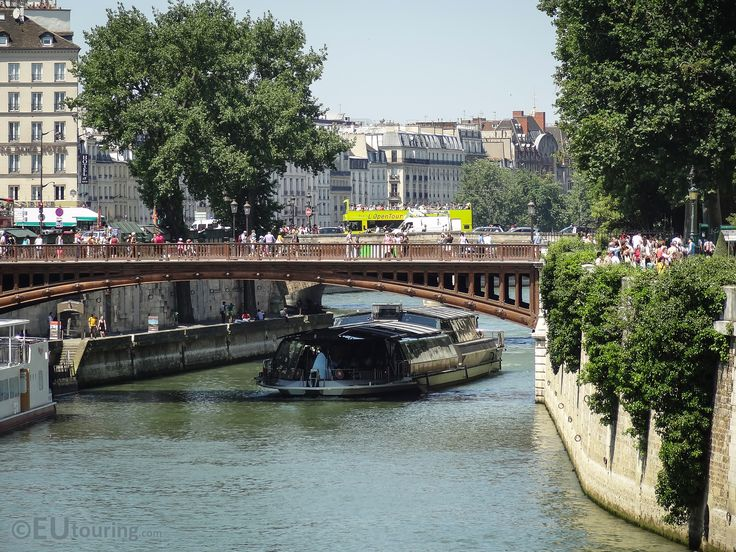 The Pont au Double, a pedestrian only bridge that crosses over the River Seine, with a tour boat travelling beneath.  You may be interested in more; www.eutouring.com/images_pont_au_double.html
