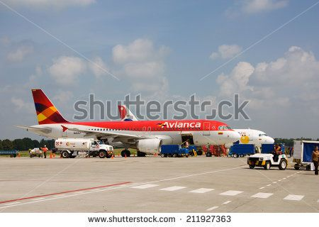 MONTERIA, COLOMBIA -  June 16th, 2014: An  Avianca flight to Medellin loading luggage on the 16th of june 2014 Monteria, Colombia. Avianca is the national airline of Colombia.