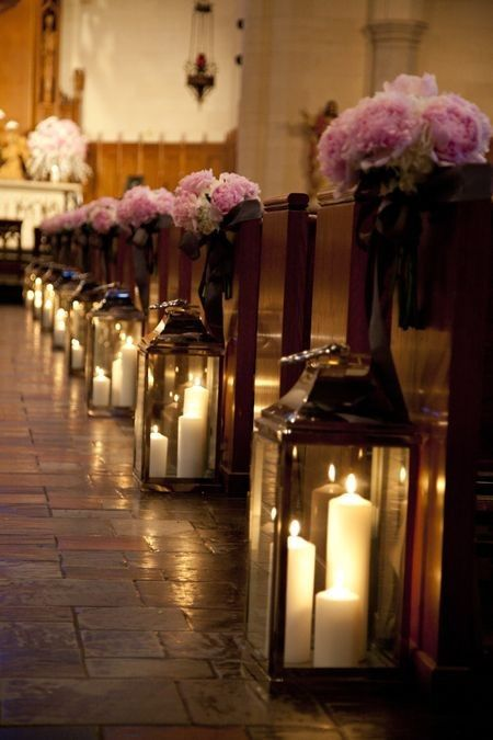 Glass lanterns and flower bouquets aisle decor for church wedding, pastel pink flowers decor ideas.