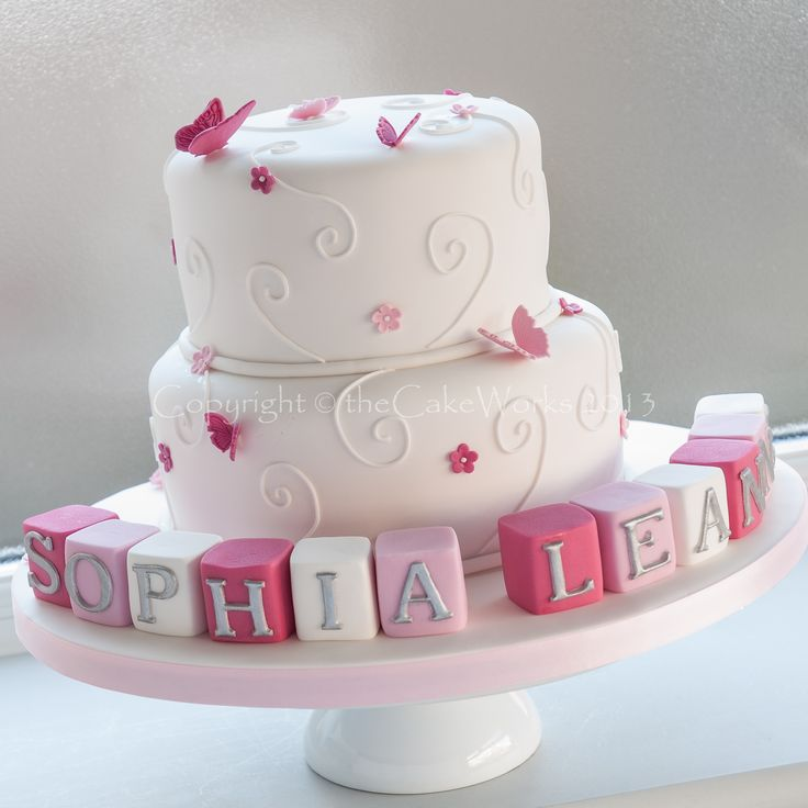 Girl Baptism Decorating Ideas | two tier girl's Christening cake with pink butterflies and Sophia ...