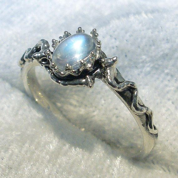 Hand crafted Sterling Silver Mythological Stone Protector ring set with a natural Adularia Rainbow moonstone. It is often called blue moonstone, blue-flash moonstone, or rainbow moonstone because of the billowy blue light that floats around in the stone. The moonstone will measure 6 mm