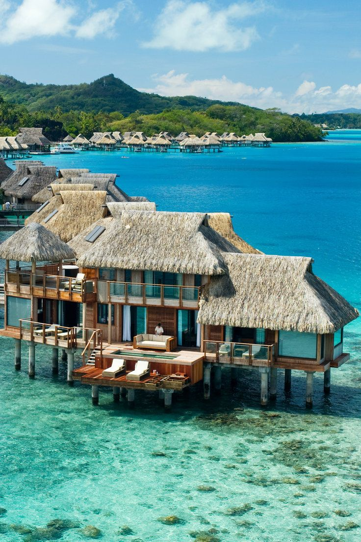 18 Swoon-worthy Overwater Bungalows - Who can resist the allure of an overwater bungalow? Everything about it spells romantic, off-the-grid seclusion, from the thatched roofs and wraparound terraces to outdoor showers and spellbinding views of the azure waters. We traveled to Tahiti, Fiji, Bora Bora and beyond in search of the best, most luxurious ones. Here's what we found.