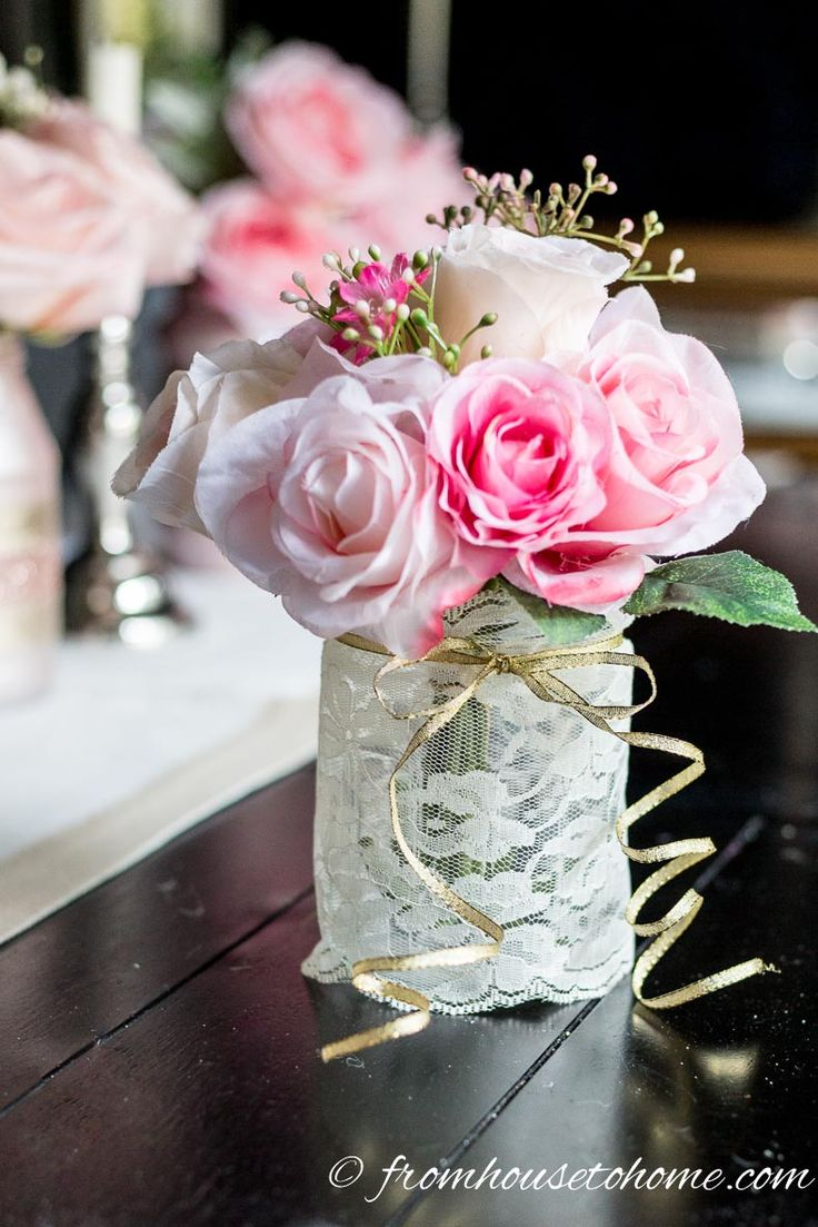 These easy floral centerpieces are GORGEOUS! So simple to make and perfect for Valentine's Day, Easter or a spring wedding. #FloralCenterpiece #SimpleFloralCenterpieces #RomanticTableCenterpiece