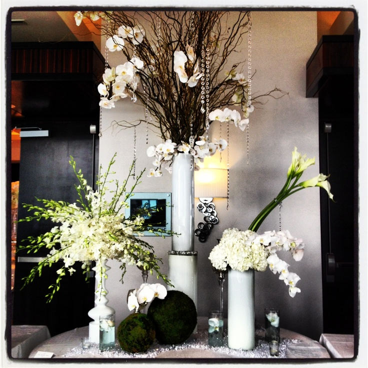 Love the branches and flowers. Maybe a guest sign in table arrangement