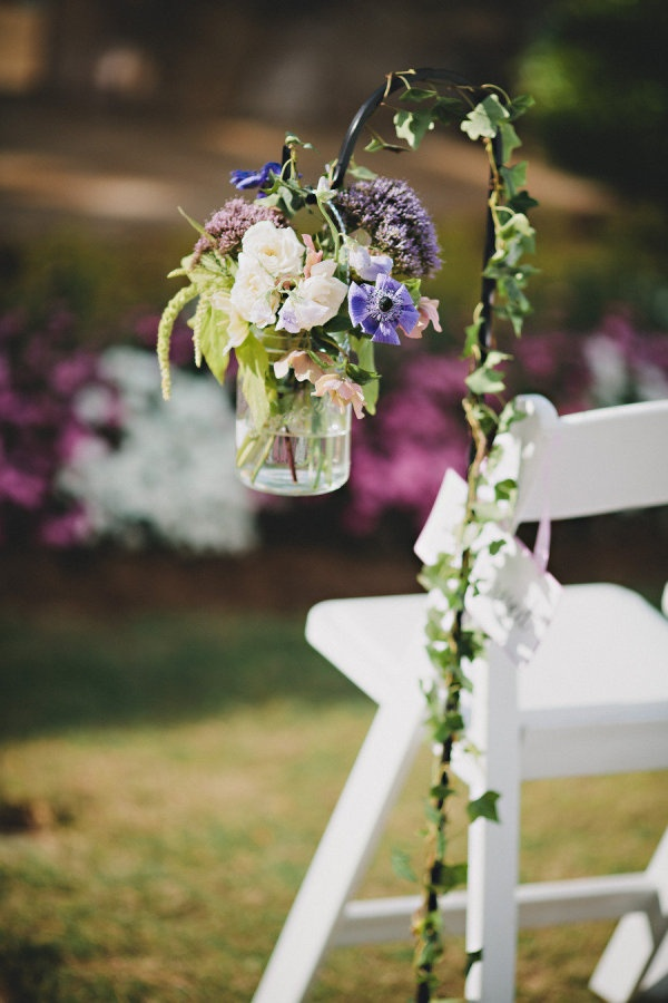Who knew a Shepherd's hook could transform into a beautiful floral wedding aisle row display?  Truly remarkable..