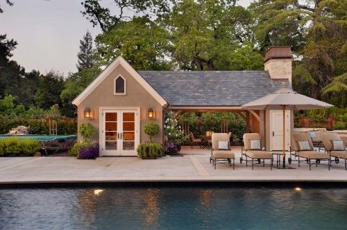 Quaint Cottage Style Pool House With Fireplace