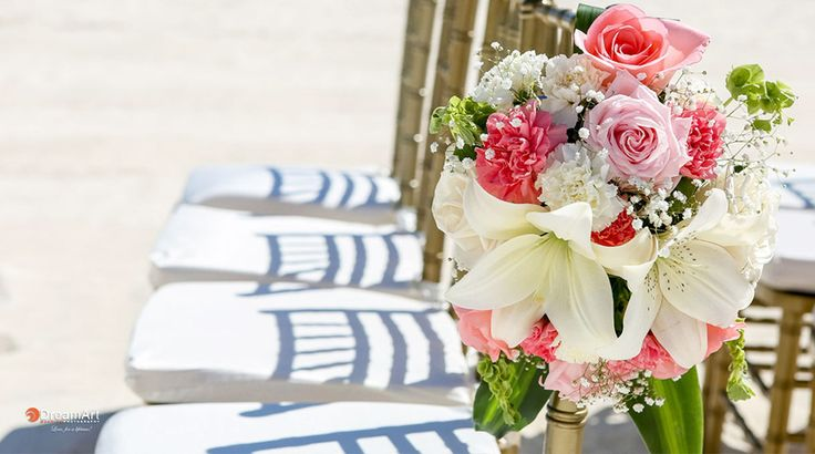 Seasonal flowers create a luscious and intimate ambiance for a romantic wedding setup.| Palace Resorts Weddings ®