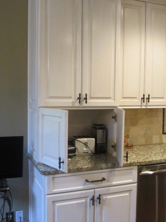 I also like the idea of a cabinet to hide all of the small appliances that need to be plugged in.