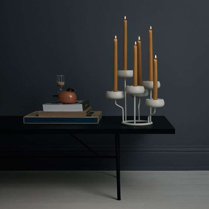 Iittala's Nappula candelabra works as a beautiful centrepiece at any table setting. It creates a relaxing ambiance with either tapered or tealight candles.