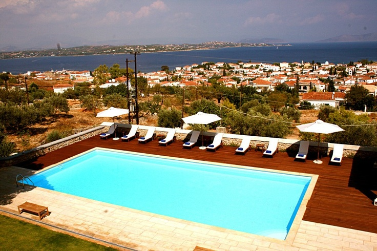 Xenon Estate villas in Spetses - panoramic view to the swimming pool as well as to the village of Spetses and the sea and mainland of Peloponnese.  www.xenonestate.gr