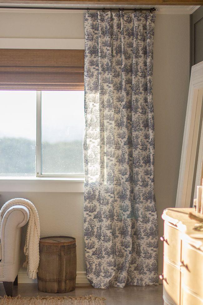 A simple DIY $12 curtain rod! With custom navy toile curtain panels