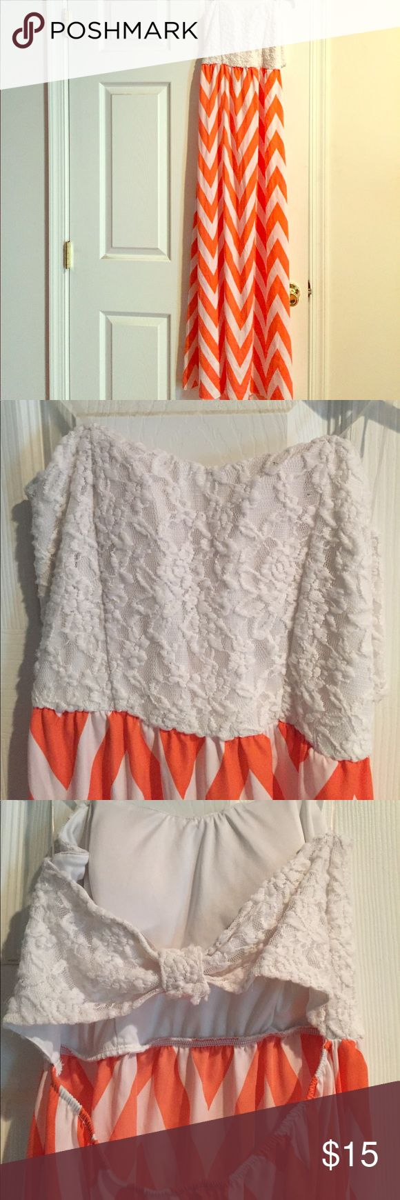 Orange chevron dress Strapless, Beautiful lacy material at the top and orange chevron dress. Picture of back in photos. Size 7-9 Dresses Maxi