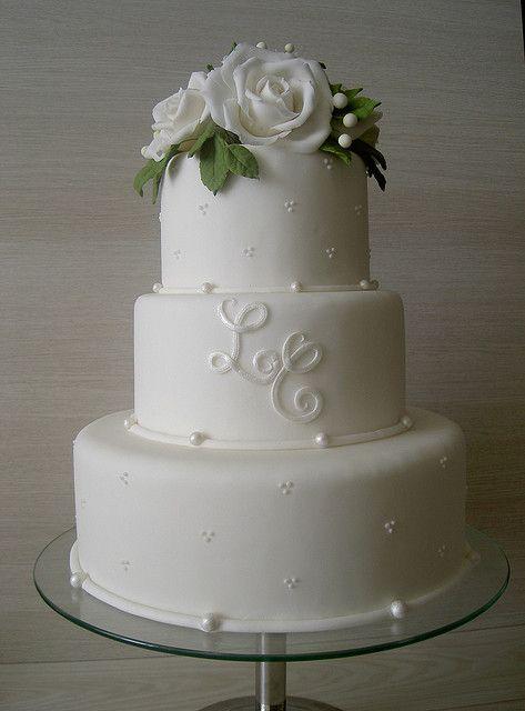 Monogram on white wedding cake, so simple and so elegant!