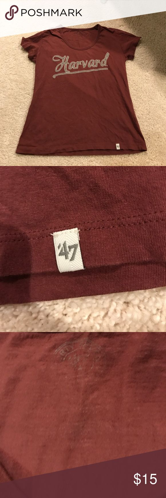 Harvard T Shirt Worn once- bought at Harvard University in Boston. The sizing part washed off as pictured. I believe it is a small. I wear a size 6 in tops and it's just a little tight. There's a small H accent on the sleeve and it has a scoop neck with cool cursive writing.  It's the burgundy color of the school with grey lettering. Tops Tees - Short Sleeve
