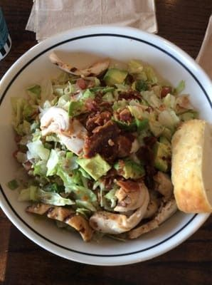 CHOPPED SALAD   Chicken, bacon, avocado,bleu cheese, tomatoes and green onions   with iceberg and romaine lettuce and sweet and spicy ...