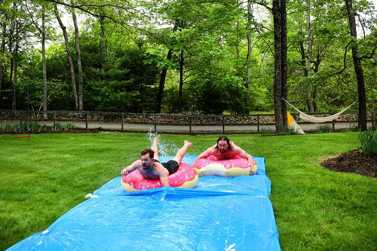 Use a plastic tarp, and a bit of soap to make this the greatest water slide EVER.