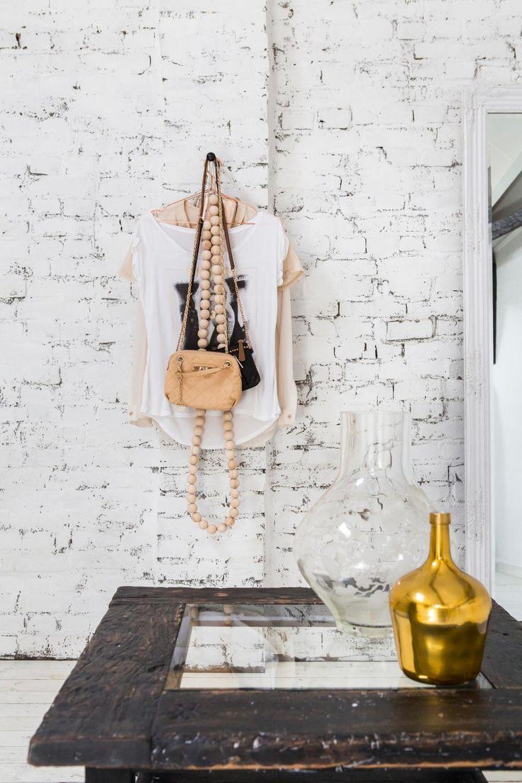 Rough stone wall with clothes hanger   Styling Odyvet van de Vin-Nelissen   Photographer Henny van Belkom   vtwonen December 2014