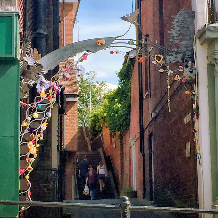 Maybe the latest #floral #yarnbomb - possibly from our undercover Gilliangladrag #knitters of corking #Dorking ,  on this beautiful metal #arch on the high street. Perhaps.