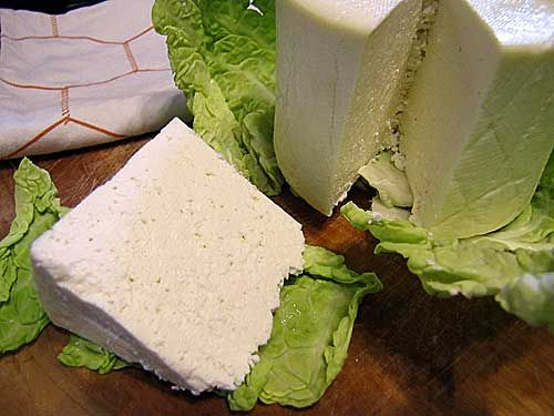 Caerphilly (pronounced CAR-filly) is a cute little town in Wales with a massive 13th-century castle. It's also a cute little cheese that is aged in less than 3 weeks. That's even quicker than Farmhouse Cheddar! [Insert Suzanne throwing Farmhouse Cheddar recipe out window.] Actually, Caerphilly is a farmhouse-style cheese and has some things in common …