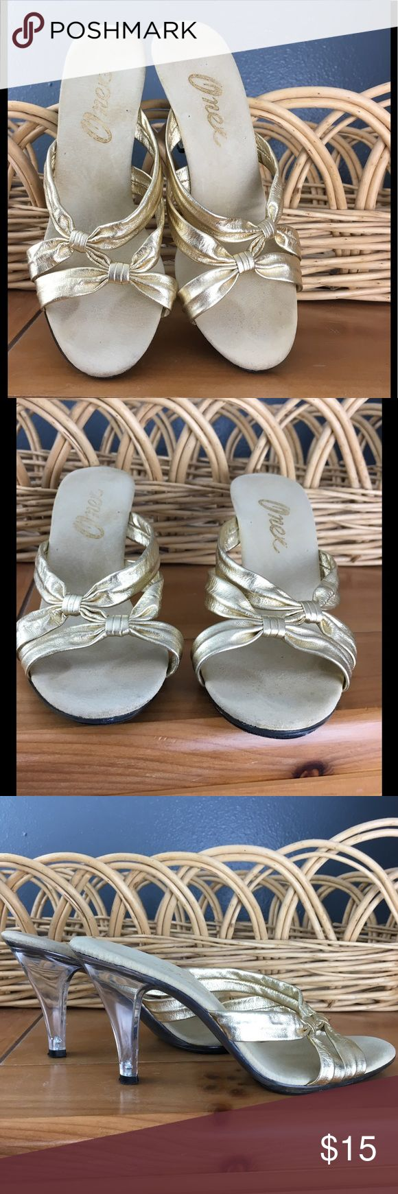 """Onex gold strappy backless heels Shiny gold straps to slide your feet into. Bottoms and heels are clear and 3.5"""" high- see picture. Gently worn. Bundle 2 or more items for 25% Bundle 2 or more items for 25% discount. onex Shoes"""