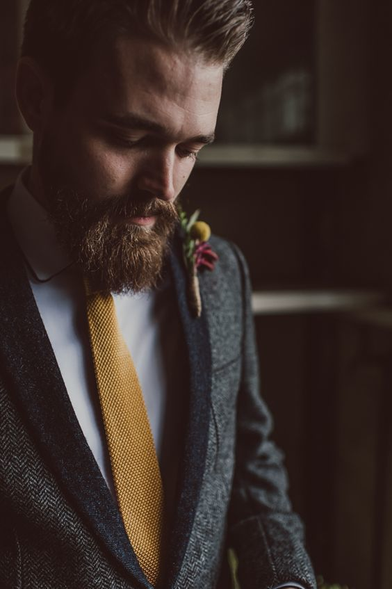 A well-kept beard is the top groom fashion trend for fall weddings. If he's going to grow it out, a fall wedding is the best time to show it off in all its burly glory even with a wedding suit.