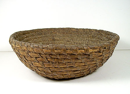 This antique rye straw basket looks like it would have been a good proofing basket for bread making.