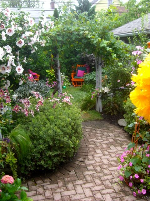path, annuals, shrubbery, hanging baskets, climbing vines, arbor,and colorful, shady seating for whimsy