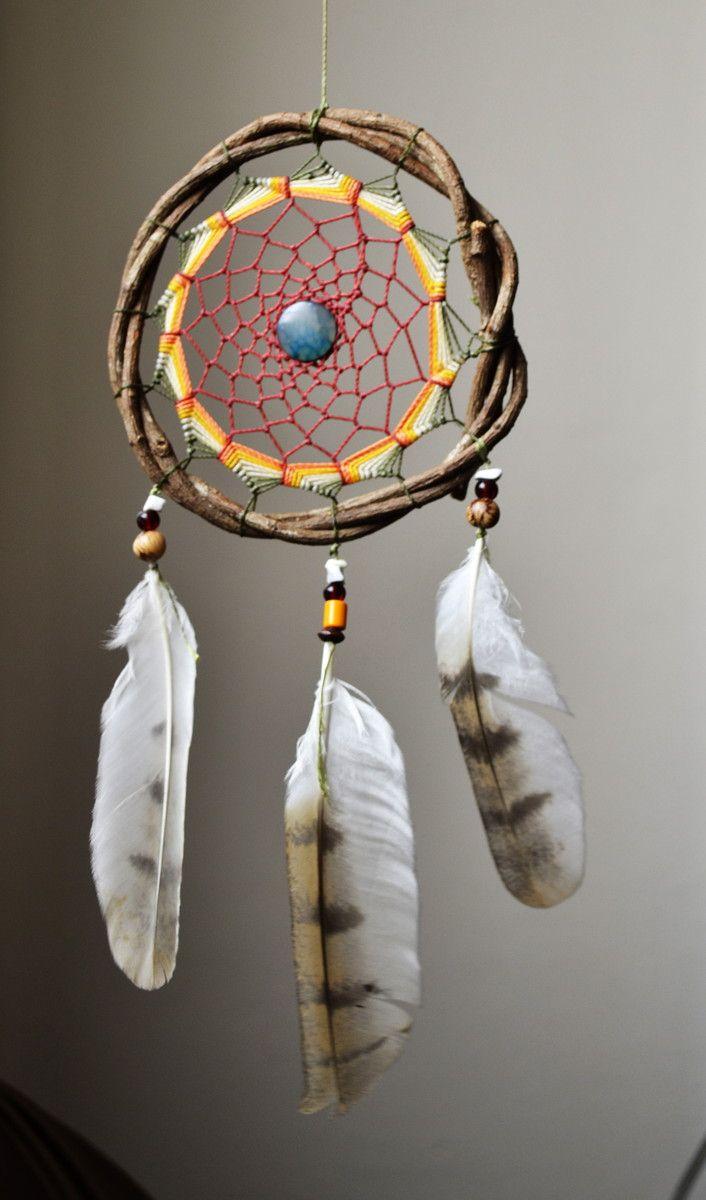 penas de coruja branca, com fios encerado em 5 cores , quartzo azul no centro e hawlita