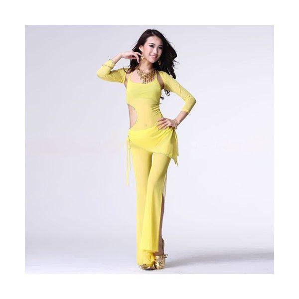 ТРЕНИРОВОЧНЫЙ КОСТЮМ  Откровенный тренировочный костюм практически полностью выполнен из полупрозрачной ткани. Длинные брюки имеют разрезы до бедра, украшением служит короткая юбочка этого же цвета, окаймленная серебристым шнуром. На топе сбоку есть полукруглый вырез, также обработанный серебристым шнуром.