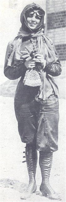 Harriet Quimby born 1875, first American woman to be licensed as a flyer. She created a trademark purple flying costume — a satin jacket with a soft cowl around her head, high laced boots and satin riding pants.