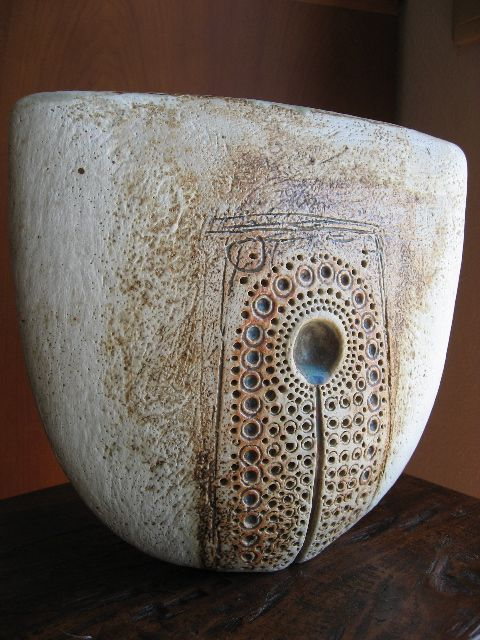 Oval vessel with impressed decoration; decorated with glaze and oxide stain washes by Alan Wallwork