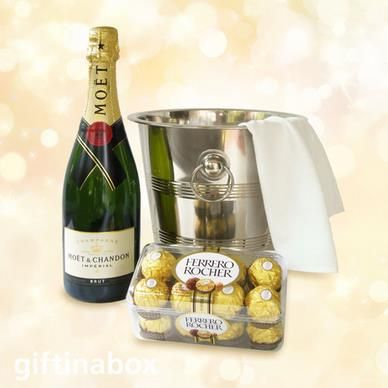 CELEBRATION TIME  Perfect for that Special Occasion! Moet and Chandon champagne presented in a beautiful ice bucket with chocolates   Bottle of Moet et Chandon champagne Box of 16 Ferrero Rocher chocolates Stainles steel ice bucket