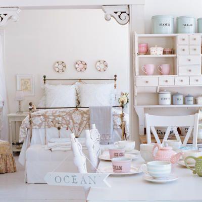 Doorway finials,,,, soft aqua tea cup stripes.... pale pink dish accents.... the crisscross chair back... ah!