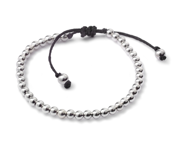 Sterling silver beads on a black or brown cord. Layer it with your favourite bracelets.