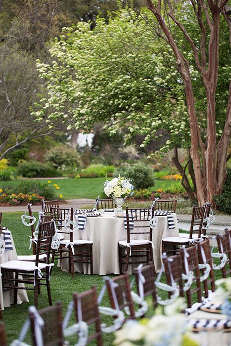 Ceremony Site: Dallas Arboretum Photographer/Studio: John Cain Photography Flowers: The Garden Gate Reception Site: Dallas Arboretum Cake: Frosted Art Caterer: Gil's Elegant Catering Band: The Roof Raisers Lighting: A Very Special Day