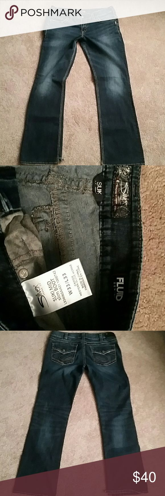 Women's Silver Suki Jean's 33x33 Dark distressed,  flap back pockets, mid rise, slim boot, excellent condition other than 2 tiny inside pant leg slots I made to cover the tops of my tennis shoes. Silver Jeans Jeans Boot Cut