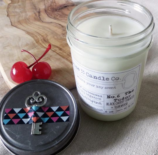 for your man or lady, unisex scent No. 6 The Tudor | Black Cherry Tobacco + Teakwood soy beeswax candle with essential oils, all-natural organic, dye-free, in a key adorned preserve jelly jar $12.00 #valentines #candles #tudor #cherry #tobacco (http://www.house33candleco.com/scent-no-6-the-tudor-black-cherry-tobacco-teakwood-soy-beeswax-candle-with-essential-oils-all-natural-organic-dye-free/)