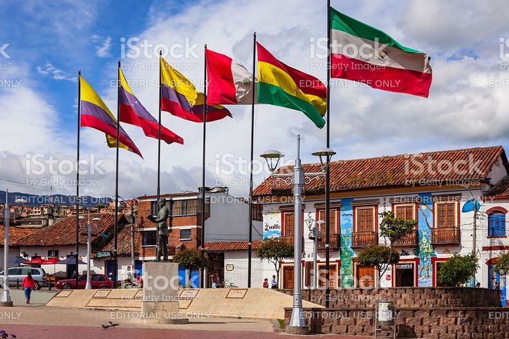 Colombia - Flags on Independence Square in Zipaquirá royalty-free stock photo