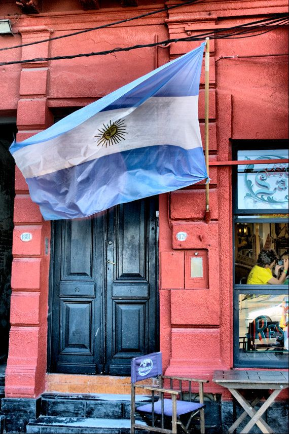 There are two theories about the colors of Argentina's flag. One of the theories is that the two blue stripes represents the Rio de la Plata (River of Sliver). White stripes represents the metal sliver. Argentina originates from the Latin word Argentum which means sliver.