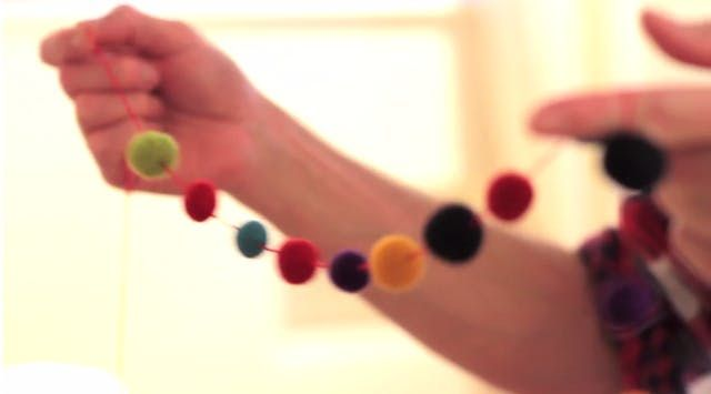In today's video, Maxwell brings us a step-by-step holiday how-to for making Felt Ball Garlands