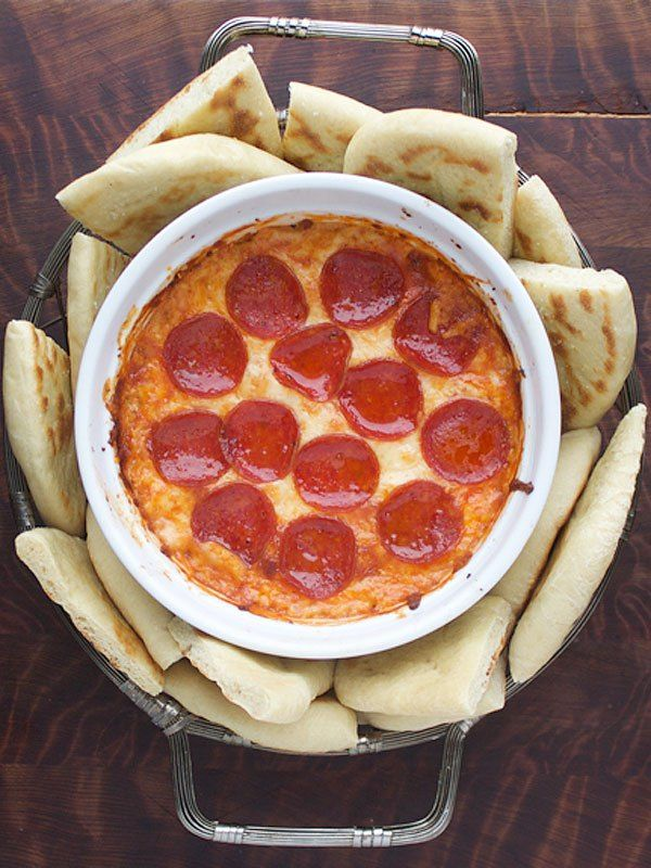PIZZA DIP Why have one pizza dip when you can have two? This four-layered creation is the best qualities of pizza in dippable form.