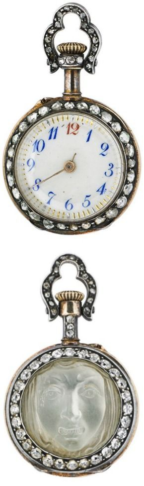 CARVED MOONSTONE GRIMACE CAMEO AND DIAMOND WATCH, Cabochon moonstone carved as a scowling mask, open face watch on reverse, rose cut diamond bezels on both sides, diamond stem and bail, silver-topped gold, pin set, Swiss movement, ca. 1890.