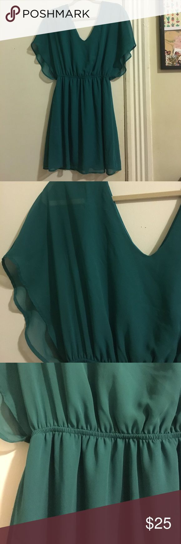 Francesca's Flowy Double V Neck Dress I have had such lovely evenings in this dress. Perfect for dinner dates and auditions or interviews. Teal color, very loose and flowy, a very pretty darker blueish teal color. Size medium. An inch or two above the knee for me, 5 ft 4. Francesca's Collections Dresses Midi
