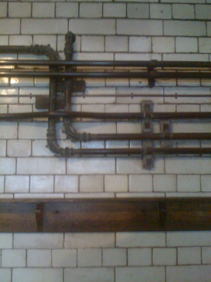 tile and pipe work. old toilets.  Manchester, UK