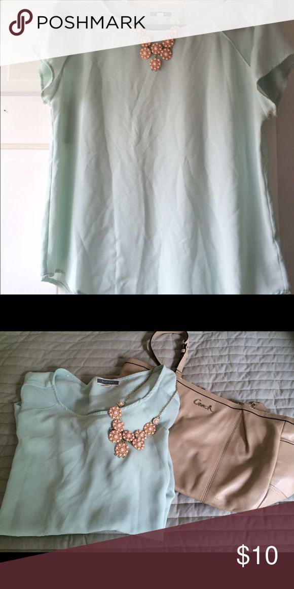 Mint green top Mint green top.  Great condition.  Comes from a pet-free, smoke-free home. Tops