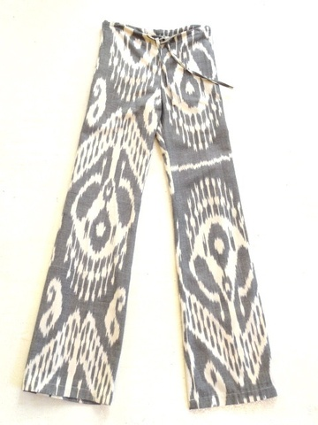 """Not your average drawstrings - our pants have a long lean silhouette, with a slightly flared leg and mid-rise waist. Not a print, these are made of 100% hand-loomed genuine imported cotton ikat, and in a very limited edition. 31"""" inseam.hand wash or dry clean only.Natural variations and breaks in the weave are inherent to the handwoven nature of genuine ikat and are part of their intrinsic value, not imperfections."""