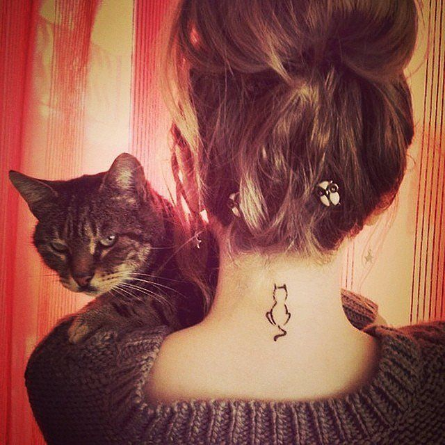 Not only is this cat tattoo totally adorable, it's easy to hide when you let your hair down. Tiny tattoos are the perfect way to start getting into ink!