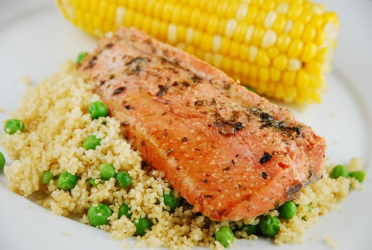 Checkout this healthy and flavorful salmon recipe at Laaoosh.com! The salmon is marinated in Italian seasonings and then broiled and served over whole wheat couscous.