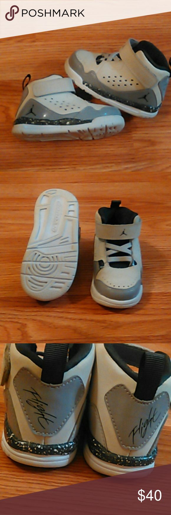 Jordan Flight baby tennis shoes like New These are so adorable!!!Jordan s baby tennis shoes size 5c like new condition white with dark and light shades of grey that will match any outfit. Velcro. Boy or girl could wear!! Jordan Shoes Baby & Walker